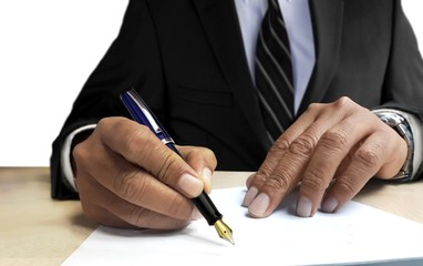 Man in suit writing on blank paper from front view angle