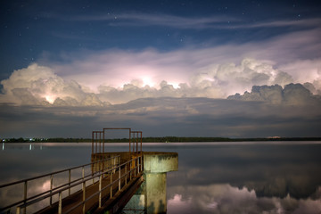 The bridge extends into the lake. And clouds, rainstorms and stars.