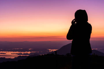 silhouette shadow traveler on high mountain in sunset time