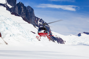 rescue helicopter landing on a glacier.