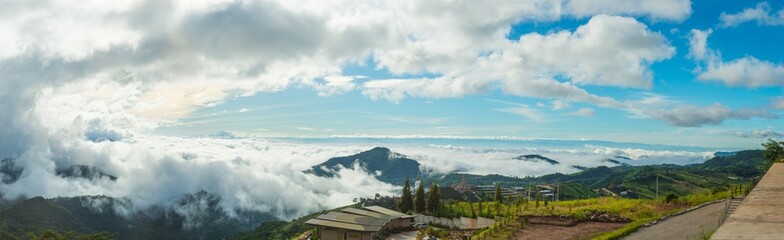 Panorama view blue sky and cloudy of nature and top view of Wat Pha Sorn Kaew Temple or Wat Phra Thart Pha Kaew Temple in Khao Kho, Phetchabun Province.