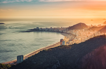 Sunset over Copacabana Beach in Rio de Janeiro, Brazil. Warm late afternoon light
