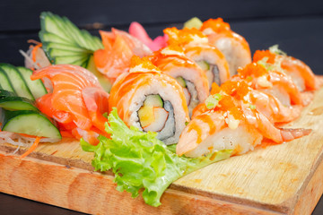 Japanese Cuisine - Sushi Roll on wood plate