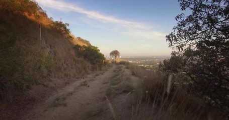 Fotobehang - Trail Hollywood Hills scenic aerial view of Los Angeles cityscape at sunset 4K
