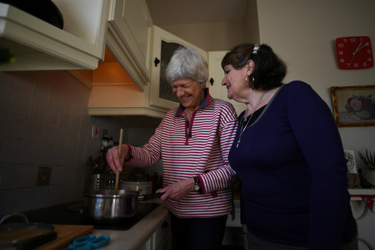 Baya Salmon-Hawk (R) and her wife Audrey Evelyn make soup in their home near New Ross