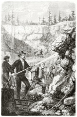 Ancient gold prospectors washing rocks with a hydraulic pump in a cave in California. By Chassevent and Gauchard after previous engraving by unknown author published on Le Tour du Monde Paris 1862