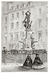 Ancient classic statue surrounded by a wrought iron fence in a old city. Ancient buildings on background. Hercules fountain Augsburg Germany. By Lancelot and Gauchard on Le Tour du Monde Paris 1862