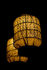 Japanese lantern glowing in the black background