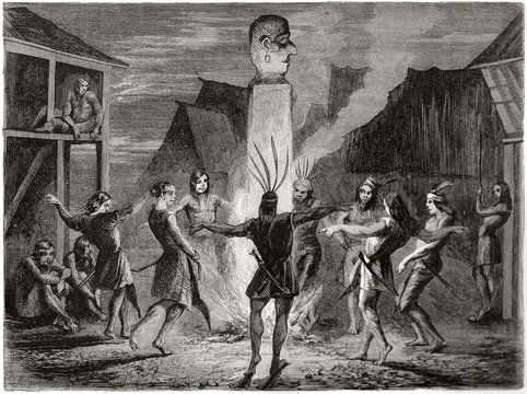 Ancient tribal people dancing in their village around a stone column with a idol on top and fire on bottom. Danum people nocturnal dance Borneo. By Lancon published on Le Tour du Monde Paris 1862