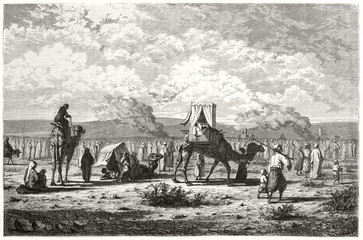 Ancient greek pilgrims caravan walking by feet or on camel boardtrough the desert . From Palestine on journey to Jerusalem. Created by Rudhardt and Gusmand published on Le Tour du Monde Paris 1862 Fotomurales