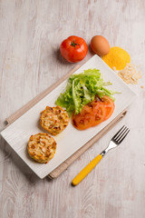chicken medallions with sliced almond and salad