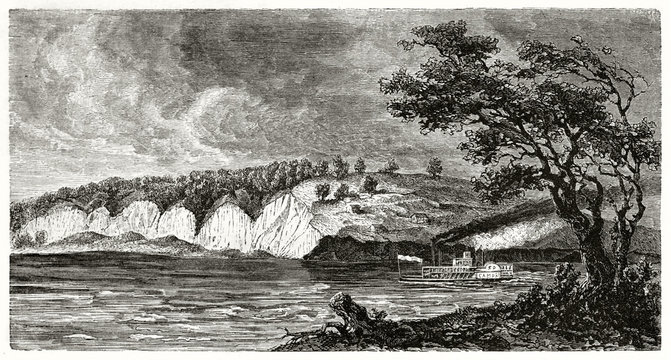 Ancient St Joseph surroundings along Missouri river USA. Steamboat sails the water under a dark stormy sky. By Guaiaud after The Geological Survey of Missouri published on Le Tour du Monde Paris 1862