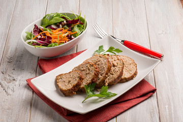 homemade meatloaf with mixed salad