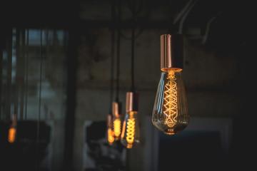 Light lamp bulb illuminated in dark room