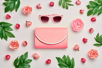 Fashion Woman Accessories Set. Pink Pastel Color. Flat lay. Minimal Style. Trendy fashion Clutch, Glamour Summer Sunglasses. Roses Flowers, leaves. Spring Floral Wall mural