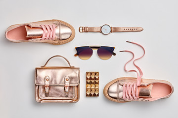 Fashion. Woman Gold Accessories Set. Trendy fashion Handbag, Gold Shoes, Glamour Sunglasses, Stylish Watch. Layout. Luxury Spring Hipster Girl Outfit. Pastel Color Wall mural