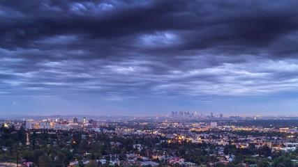 Klistermärke - Cloudy sky over city of Los Angeles cityscape dusk to night. 4K UHD Timelapse