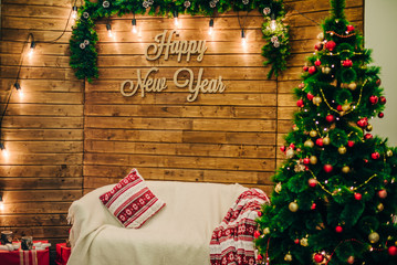 Wooden wall with New Year decoration