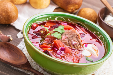 Russian borscht angled view closeup. Soup with beetroots, cabbage and beef.