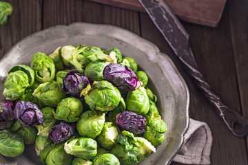 Papiers peints Bruxelles Raw fresh Brussels sprouts in plate on rustic table