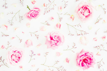 Floral pattern of pink roses, wild flowers and petals on white background. Valentines day. Flat lay, Top view.