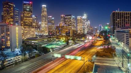Fotobehang - Aerial view downtown city Los Angeles skyline traffic freeway night 4K timelapse