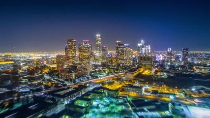 Fotobehang - Aerial view downtown city Los Angeles skyline night. 4K UHD timelapse hyperlapse