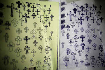 Pages displaying different Christian cross designs are seen at the studio of tattoo artist, Wassim Razzouk, who is continuing his family's tradition of inking Christian pilgrims with ancient tattoos, in Jerusalem's Old City