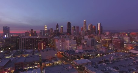Klistermärke - Aerial view city downtown Los Angeles skyline sunset twilight dusk night. 4K UHD