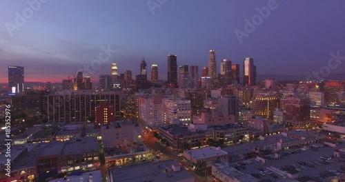 Fotobehang Aerial view city downtown Los Angeles skyline sunset twilight dusk night. 4K UHD