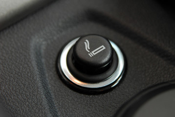 The Car cigarette lighter in a car interior