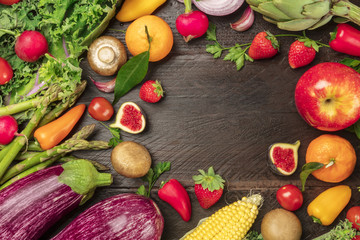 Overhead photo of fresh vegetables and fruits with copy space