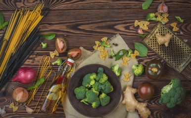 Top view of organic food and kitchen items on wooden background with copy space