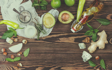 Top view of organic natural fresh healthy food on wooden background with copy space