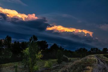 Dark cloud storm. Rain coming on the sky in the rural road view. Beautiful storm sky with dark cloud.