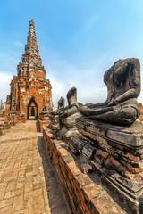 Headless Buddha statues in Wat Chaiwatthanaram Buddhist temple, Ayutthaya Historical Park, Ayutthaya, Thailand.