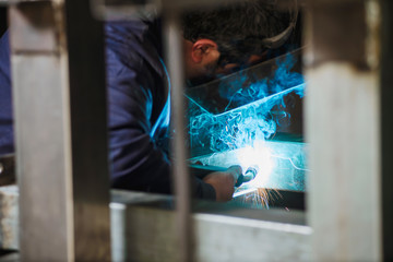 Professional welder in working process