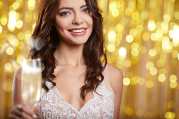 Woman in evening dress with champagne glasses - new year, celebration