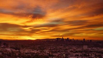 Fotobehang - Beautiful fiery red sunrise city Los Angeles skyline cityscape. 4K UHD timelapse
