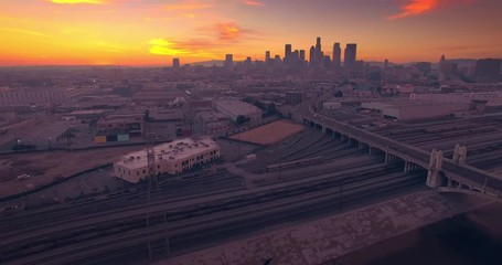 Fotobehang - Aerial view Los Angeles river downtown skyline in background at sunset 4K UHD