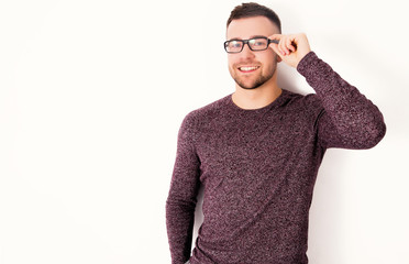 Handsome happy man in glasses isolated on a white background