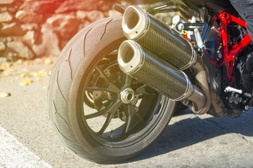 Carbon fiber exhaust system of sport bike on a road