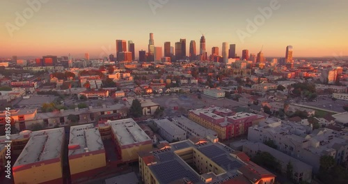 Fotobehang Aerial view downtown Los Angeles cityscape skyline sunset camera flying backward