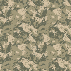 Green and khaki camouflage is a colorful seamless abstract pattern that can be used as a camo print for clothing and background and backdrop or computer wallpaper