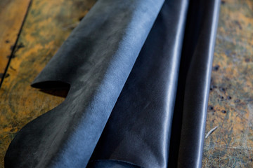 Black piece of glossy finished or crust leather