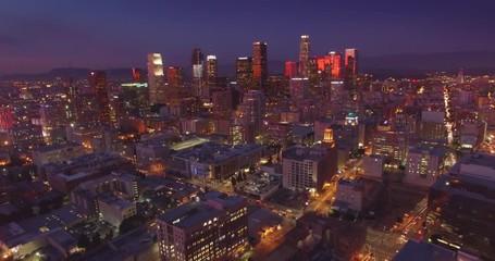 Fotobehang - Aerial view city downtown Los Angeles skyline sunset twilight dusk night 4K UHD