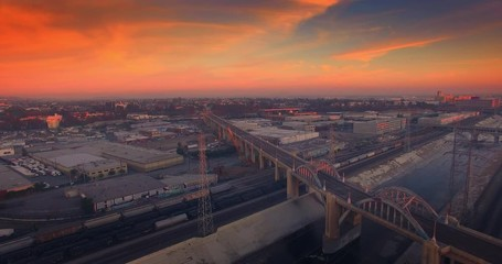 Fotobehang - Aerial view of Los Angeles river and 6th stret bridge at sunset. 4K UHD.