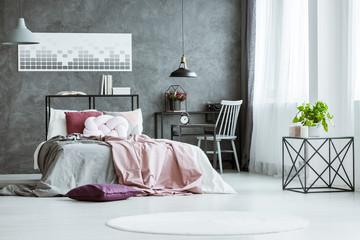 Grey designer bedroom with workspace