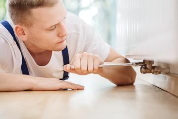 Technician specialist repairing radiator fault