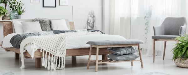 Wooden bed in simple bedroom